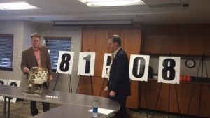 Chairman of the Board Stet Schanze draws the winning number for the 2016 Shop St. Joseph drawing.